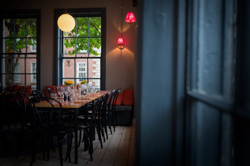dark dublin dining room with window in background