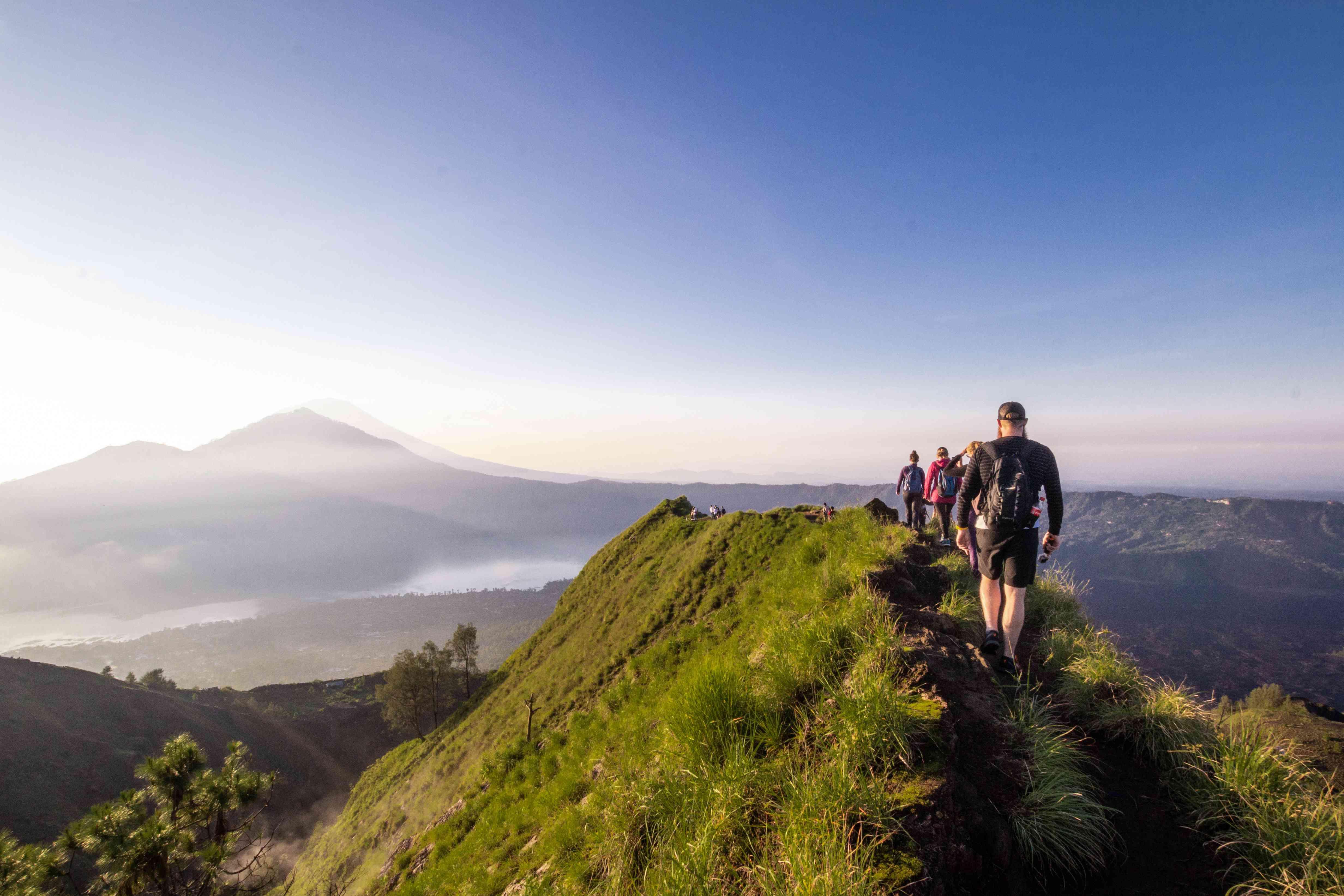 People hiking atop Mount Batur in Bali