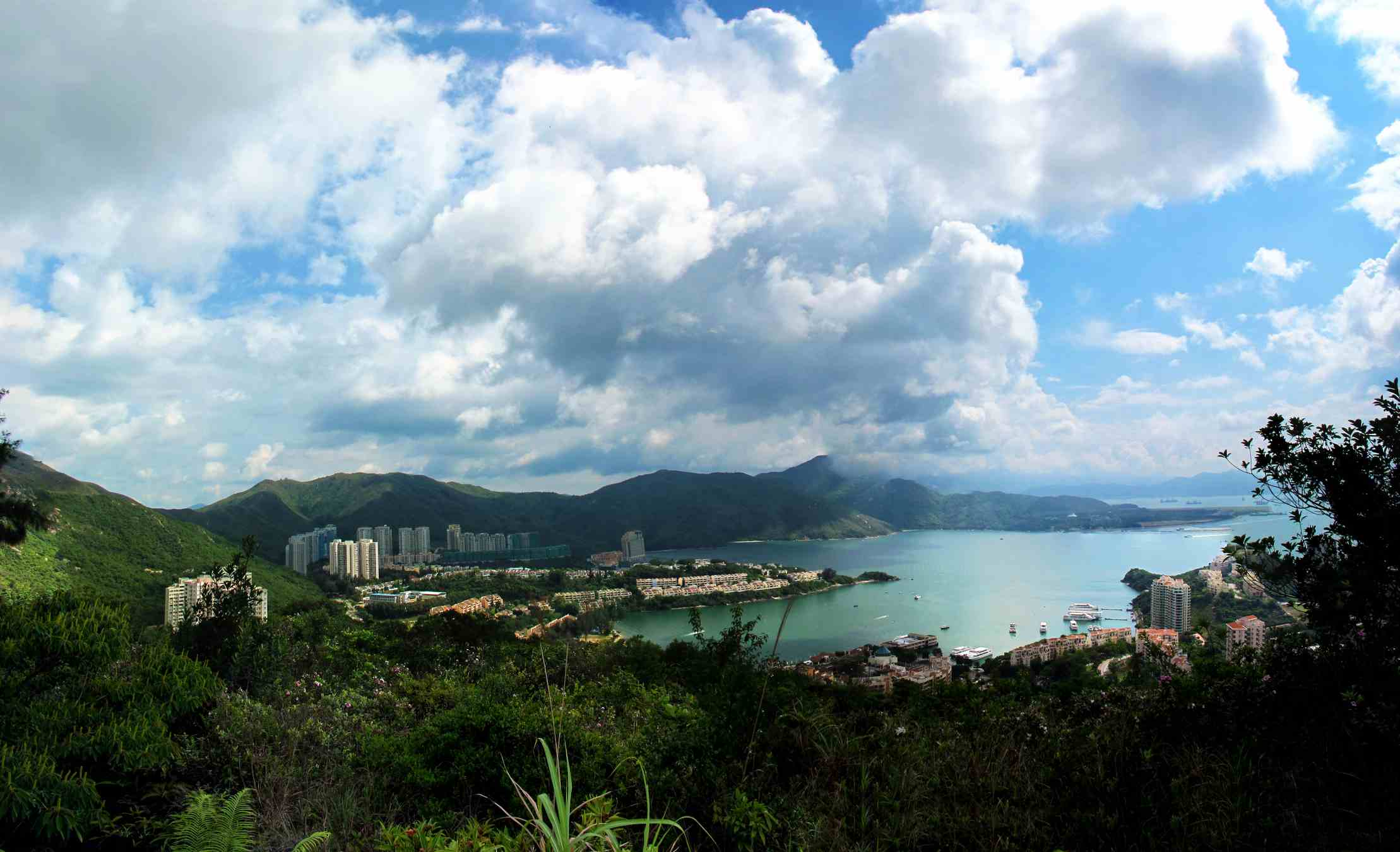 Wide view of Discovery Bay in Hong Kong and surrounding mountains and ocean