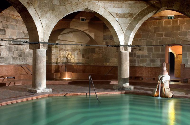 Indoor thermal baths with Ottoman-style arches