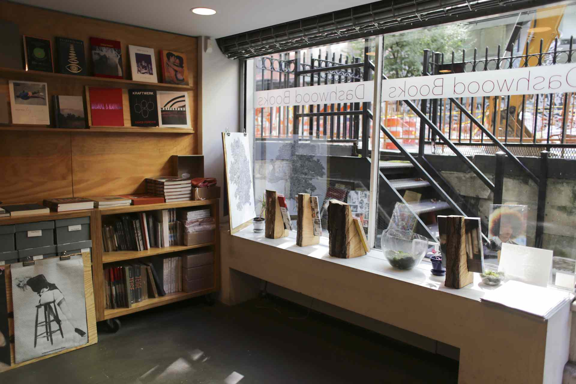 interior of a basement-level bookstore with a view out the windows