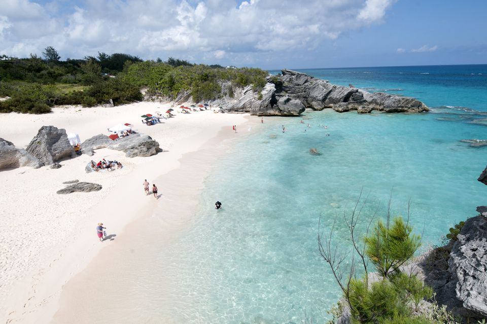 People enjoying Horseshoe Bay Beach in Bermuda.