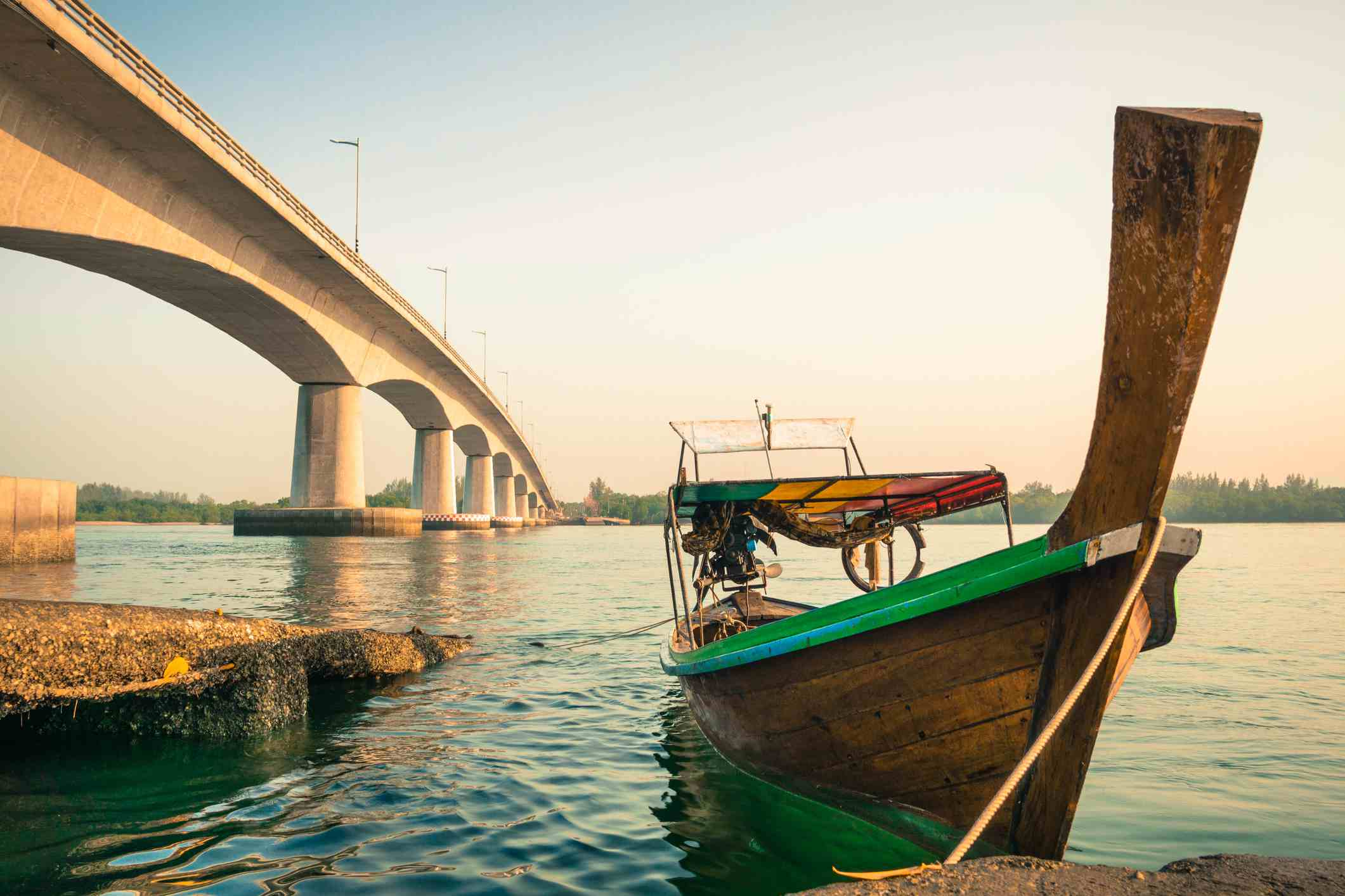 The bridge from Koh Lanta Noi and a traditional fishing boat, Koh Lanta, Tahiland
