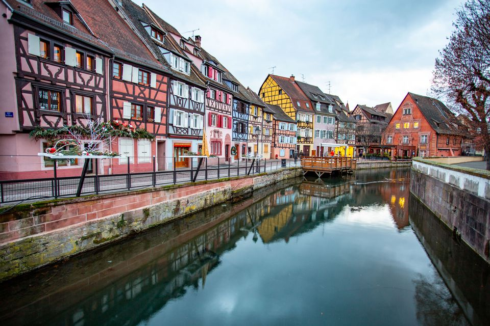 Line of colorful houses along the river in Colmar, France