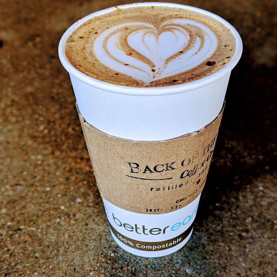 filled compostable coffee cup with latte art