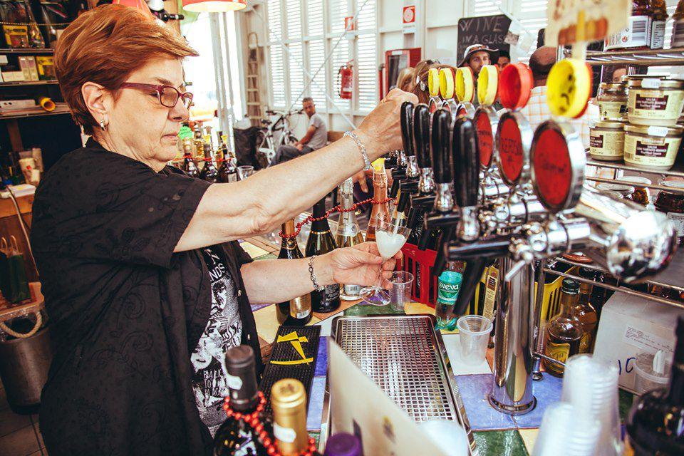 Woman serving alcohol at Mercato di Testaccio