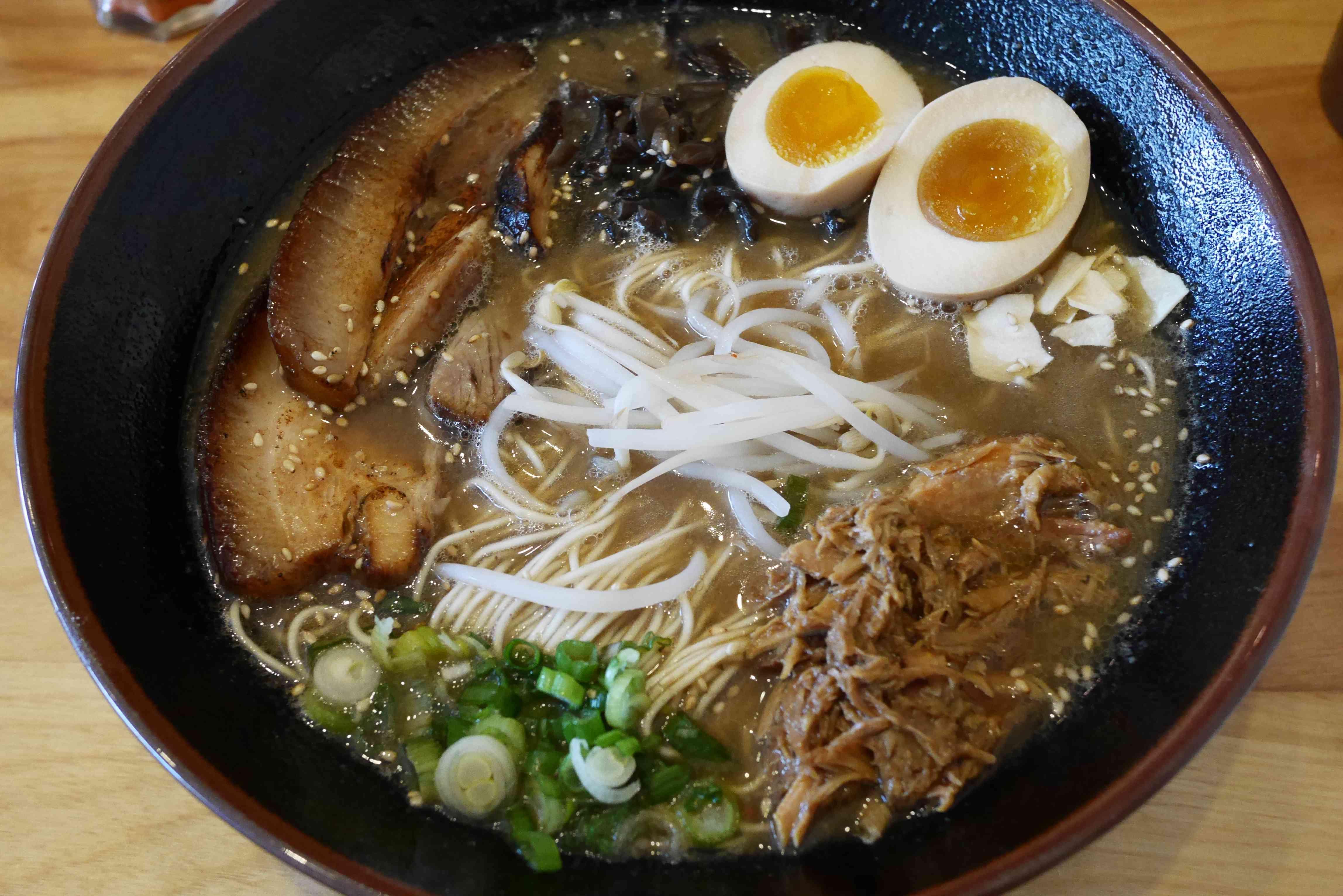 Mr. Taka ramen with pork belly, shredded pork, tofu, scallions and a split, boiled egg