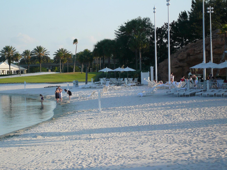 People enjoying the beach area at Walt Disney World's Grand Floridian Resort