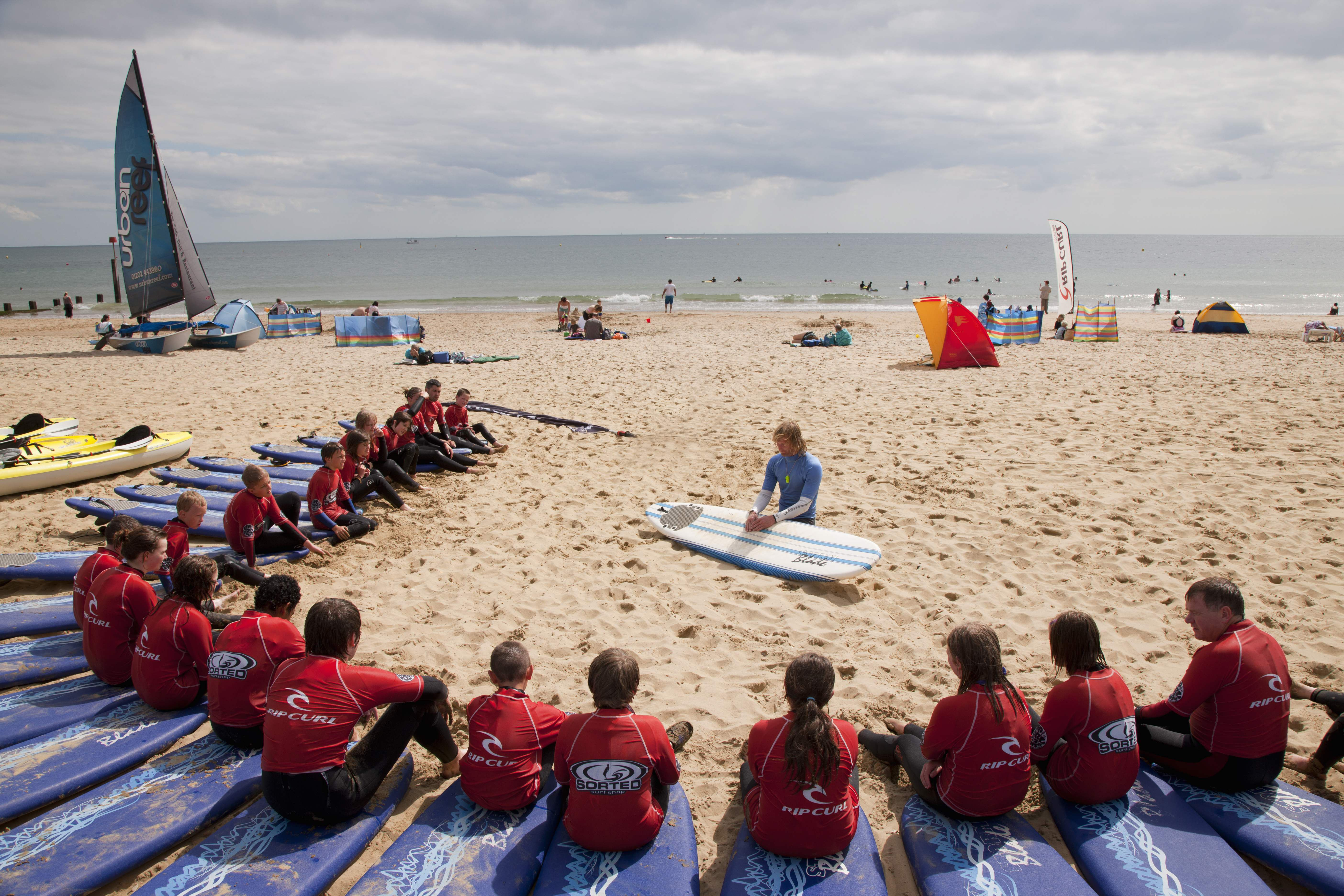 A surf lesson on Boscombe Beach, Bournemouth.