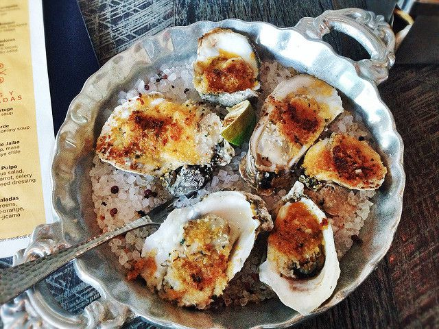 Wood-roasted Gulf oysters made with chipotle butter from Caracol