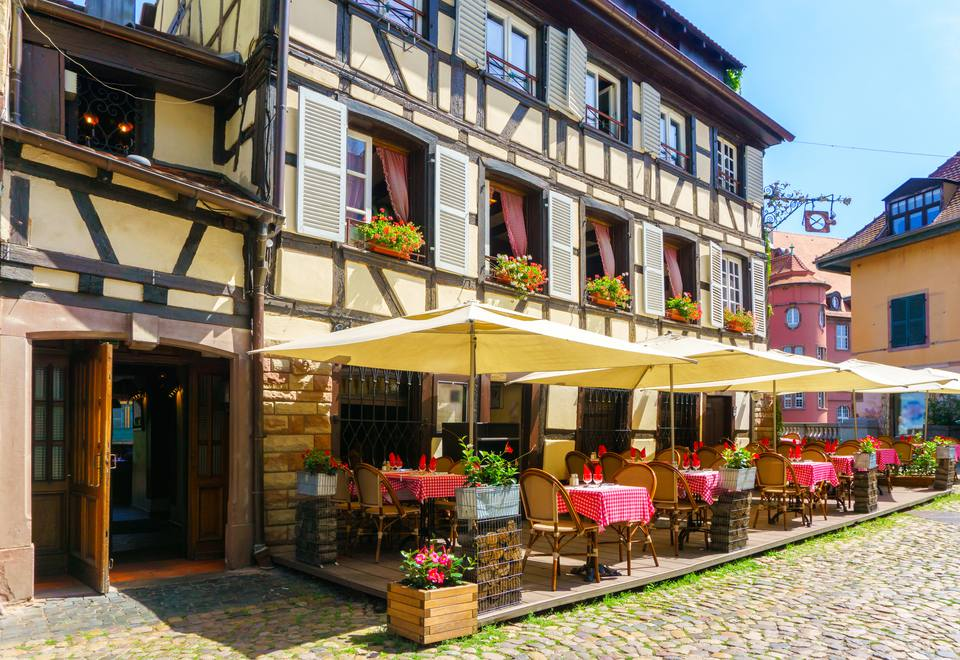 Cafes and restaurant in Petite-France in Strasbourg, Traditional colorful houses in La Petite France, Strasbourg, Alsace, France