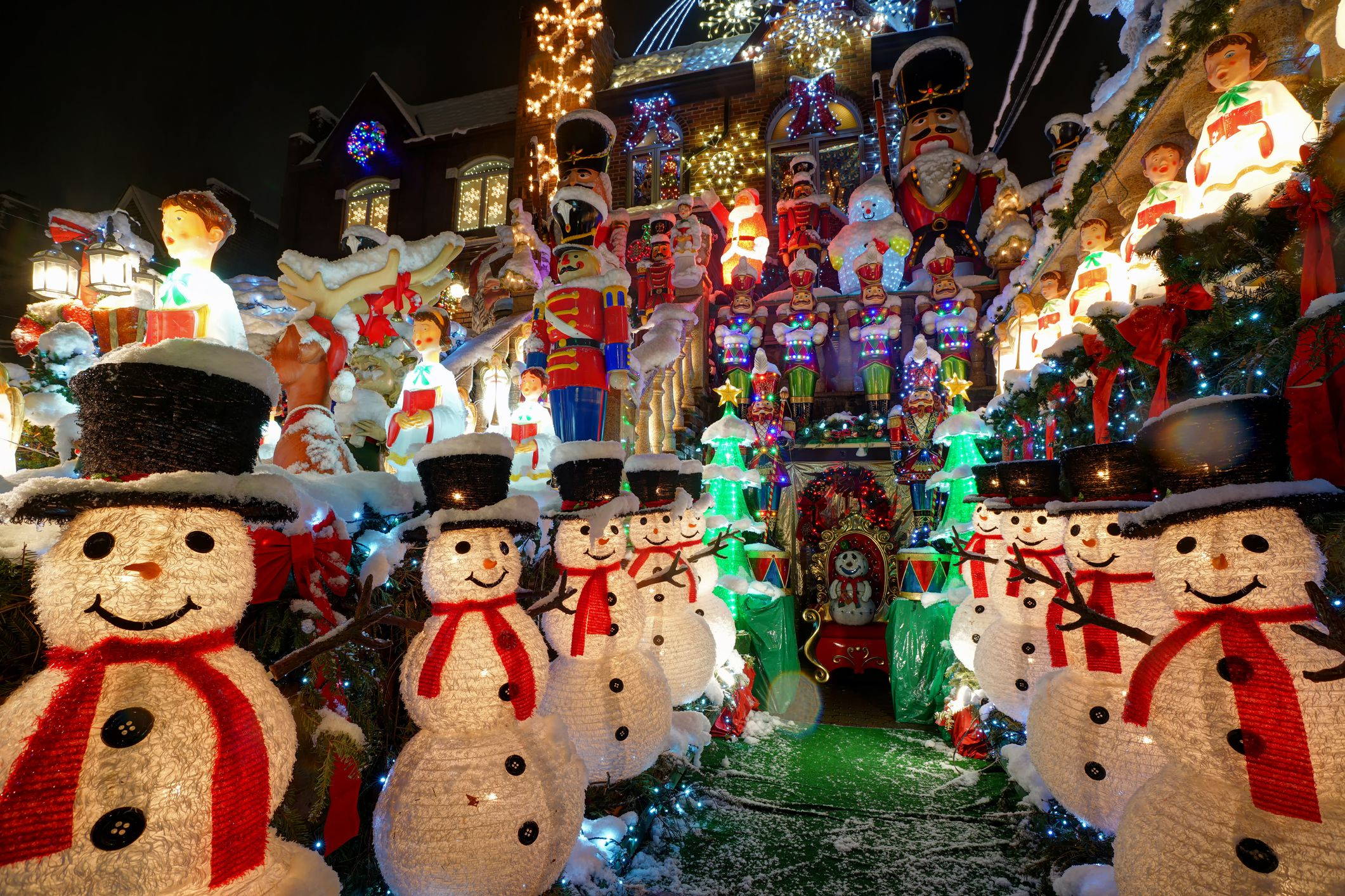 Snow-covered decorations at Dyker Heights