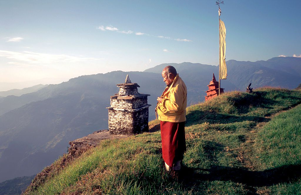 A Buddhist monk prays at Sangngak Choling Monastery, Pelling, Sikkim