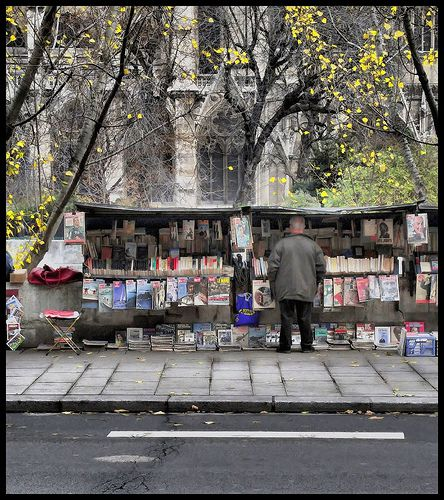 A Paris outdoor bookseller facing Notre Dame Cathedral.