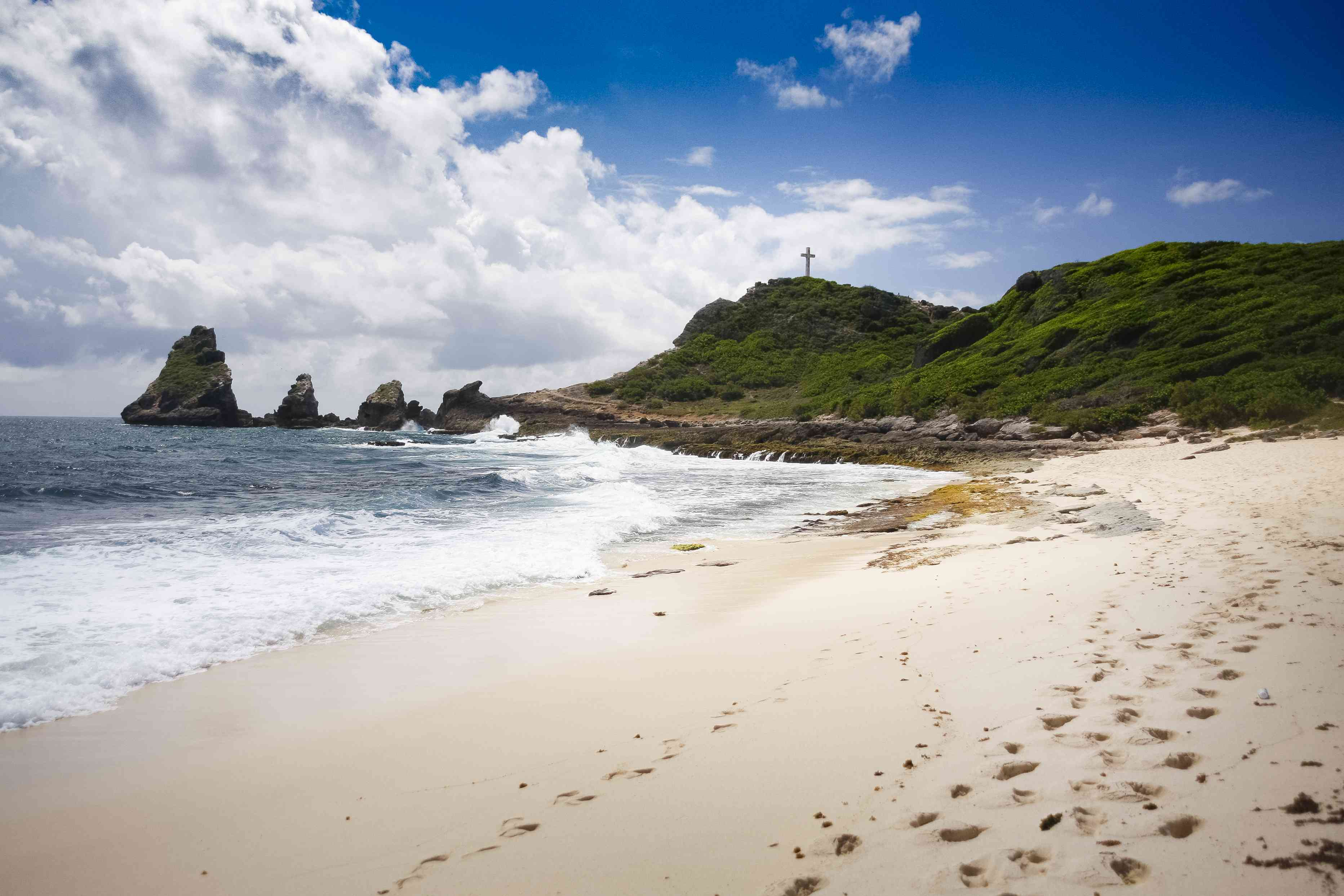 Sandy beach and tall sea rocks at Pointe des Châteaux, Guadeloupe