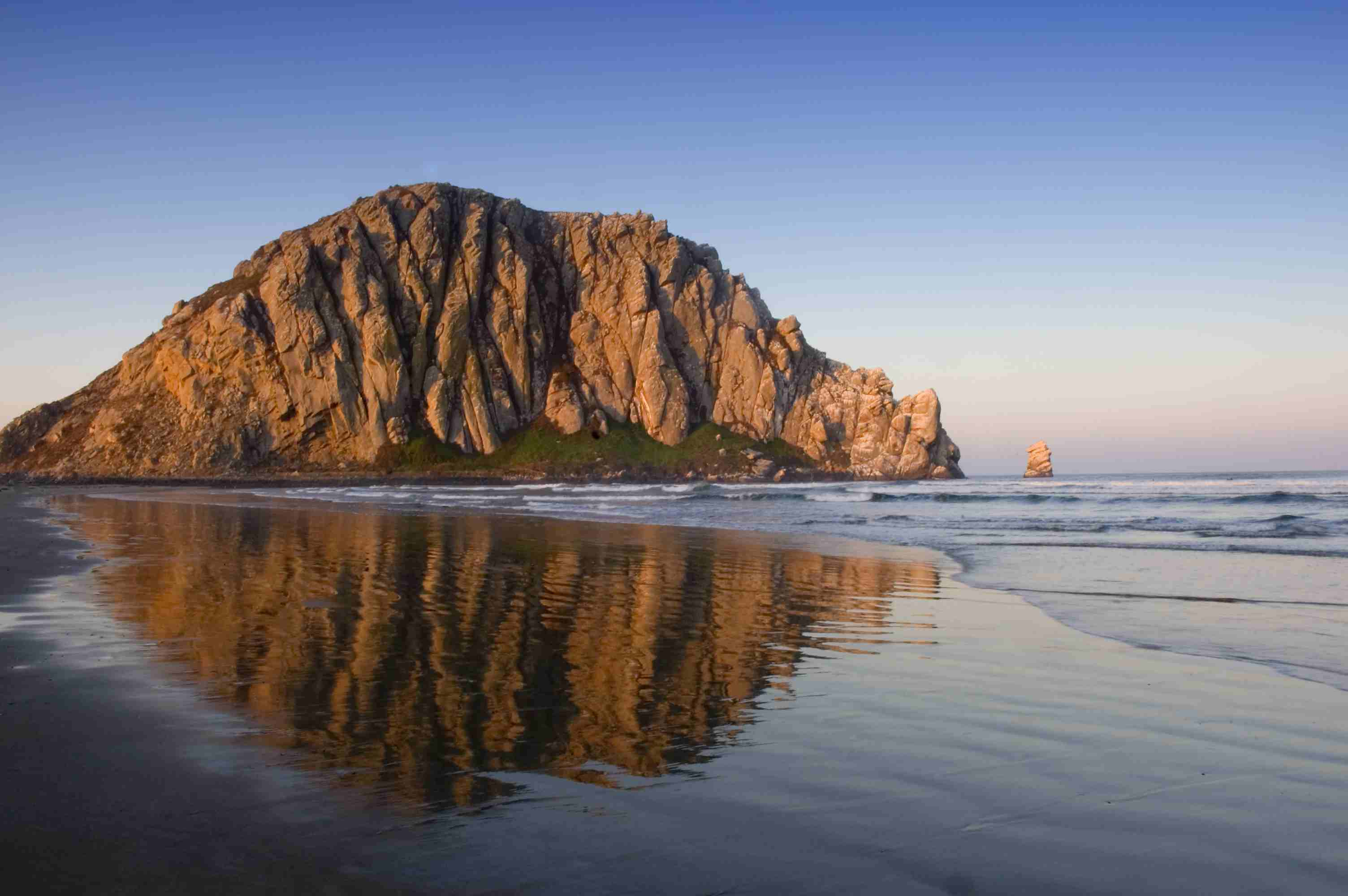 Morro Rock at sunset, reflected in the water