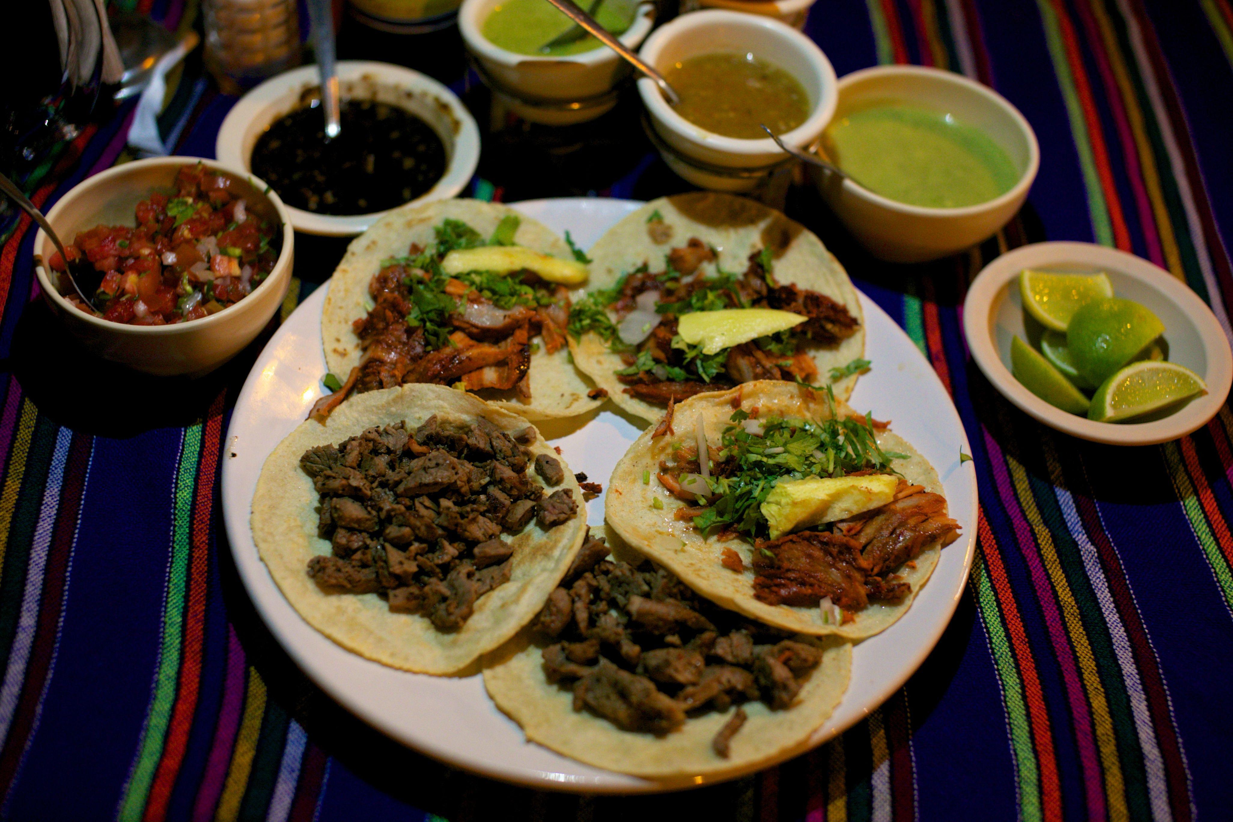 Tacos al pastor and tacos de carne asada