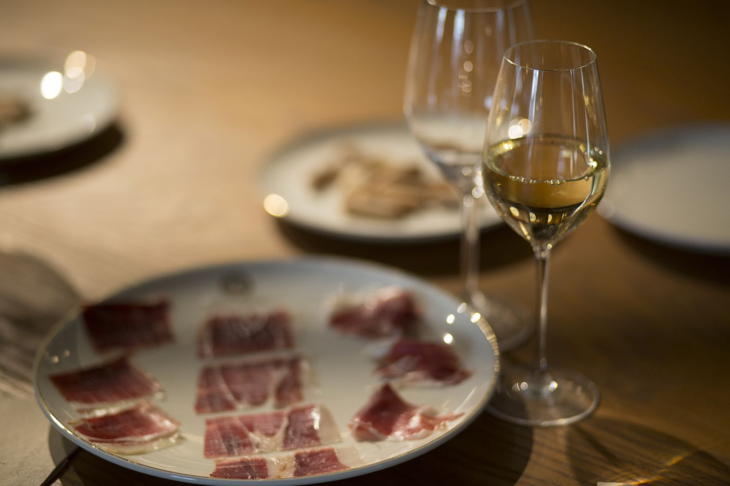 Plate of jamón and glass of sherry wine