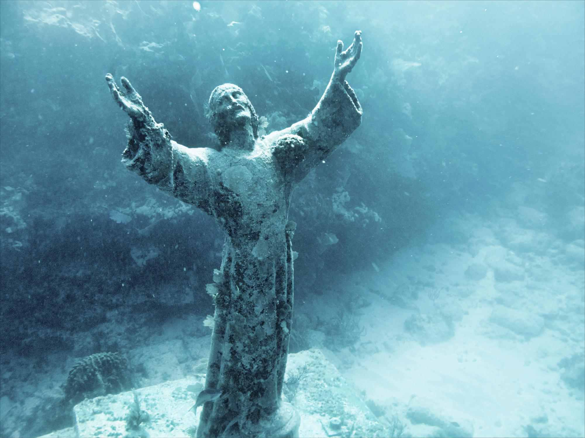 Underwater Christ On Ocean Floor Reaching With Arms Lifted To The Heavens At John Pennekamp