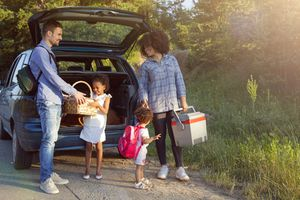 Family taking food out of car