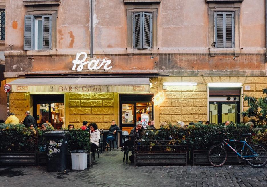 Rome bar sign with customers at outdoor tables