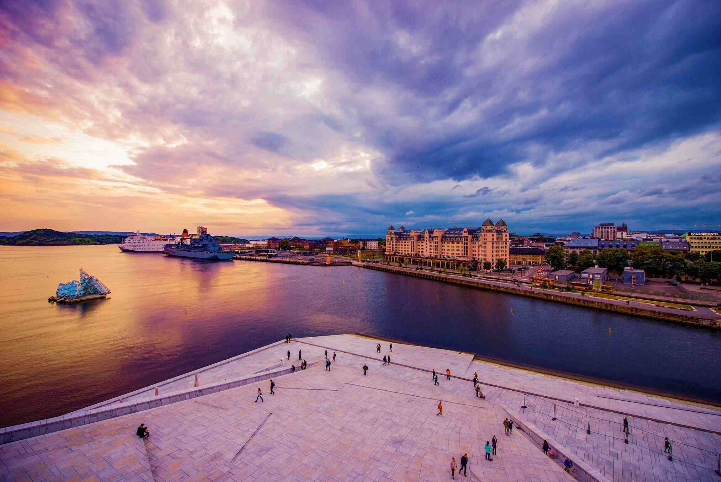 High Angle View Of People At Oslo Opera House Against Cloudy Sky