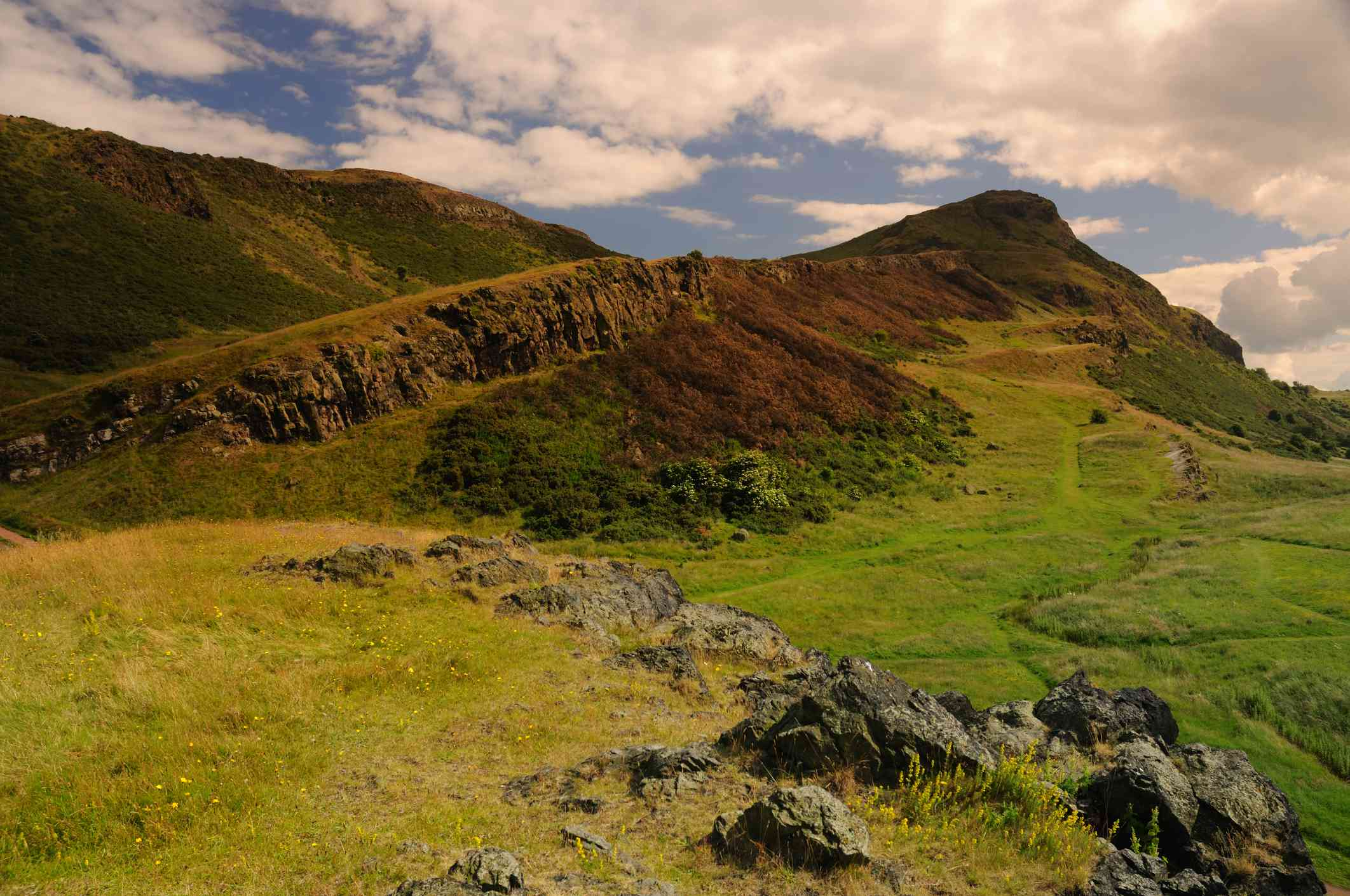 A wide angle view looking up at Arthur's Seat.
