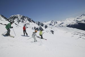 Family skiing together, Whistler Mountain, British Columbia, Canada.