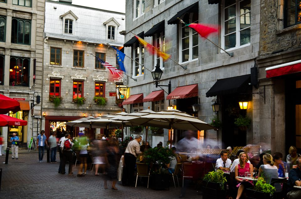 Diners at restaurant on patio in Old Montreal, Quebec