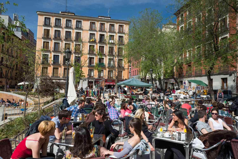 People dining on an outdoor terrace in Malasaña, Madrid