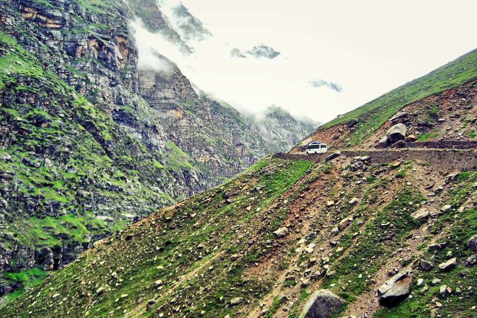 A bus makes its way along the winding road in Spiti
