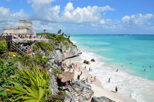 Visitors tour the beach and ruins in Tulum, Mexico