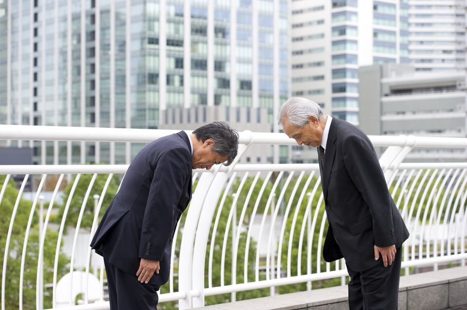 Two businessmen bowing in Japan