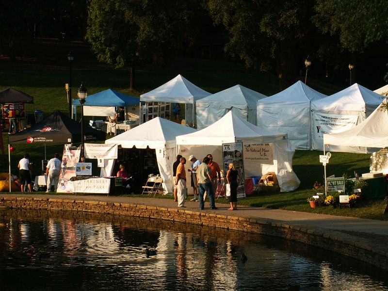 Artist tents for Festival in the Park line the lake at Freedom Park