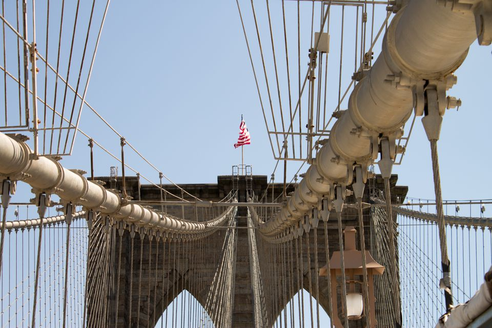 American flag on Brooklyn Bridge. This is an image of a place or building that is listed on the National Register of Historic Places in the United States of America.