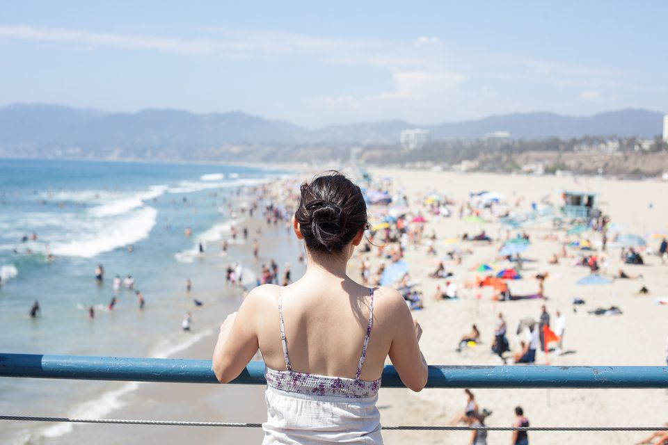 A person takes in the view from Santa Monica Pier