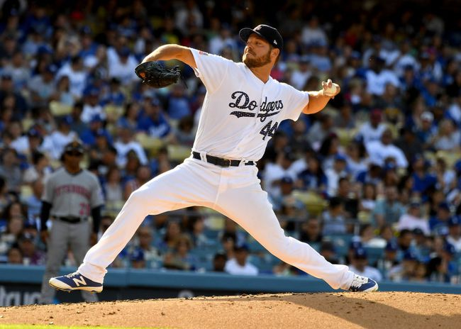 Rich Hill #44 of the Los Angeles Dodgers pitches in the third inning of the game against the Pittsburgh Pirates at Dodger Stadium on July 4, 2018 in Los Angeles, California.