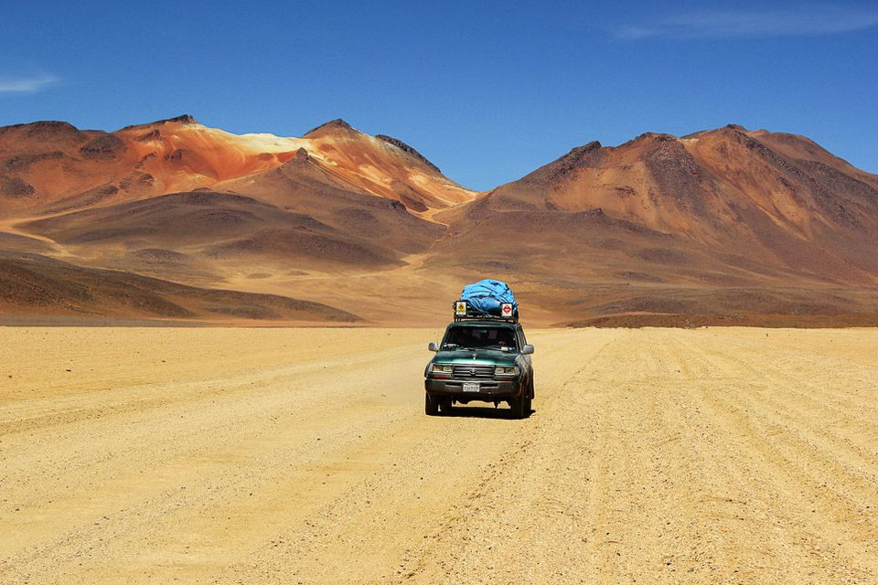Car driving through the Atacama Desert