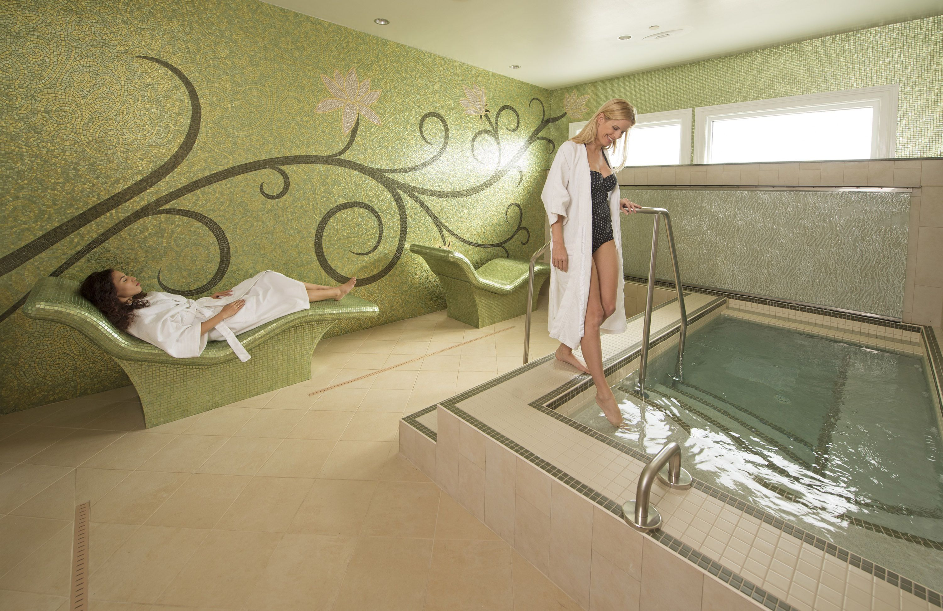 Two women relaxing by the Jacuzzi at the spa in the Grand Floridian Resort