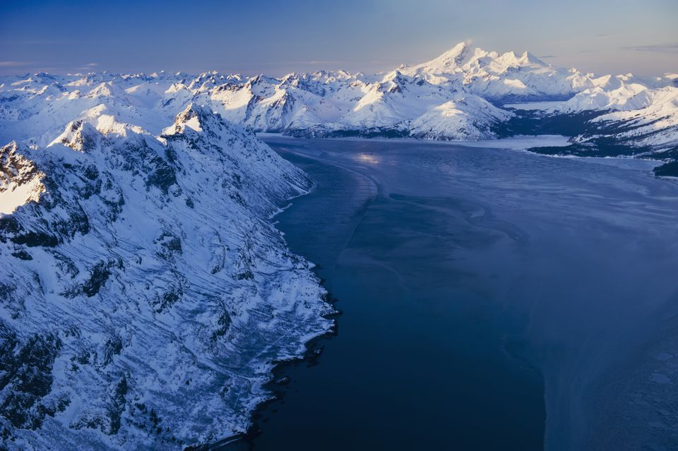 The Alaska Range rises around Iniskia Bay on Cook Inlet in Alaska.