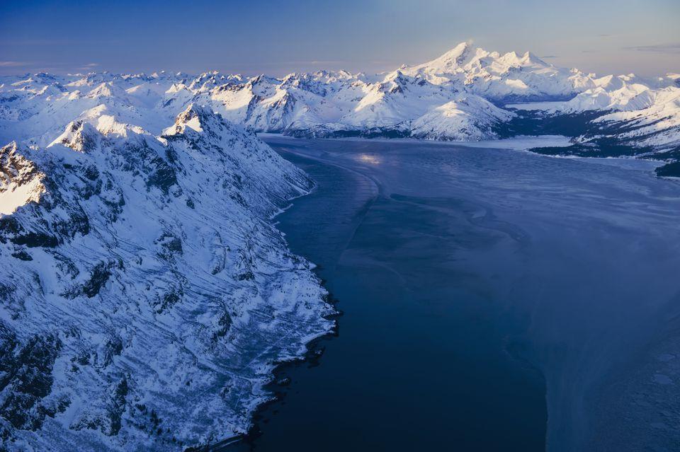 The Alaska Range rises around Iniskia Bay on Cook Inlet in Alaska.