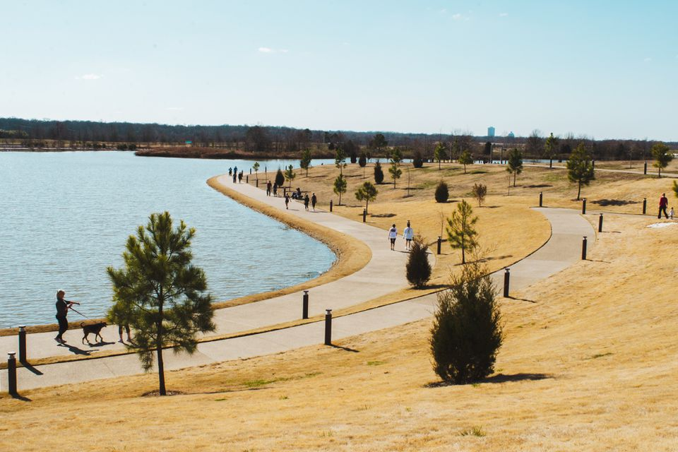 People walking around the lake at Shelby Farms