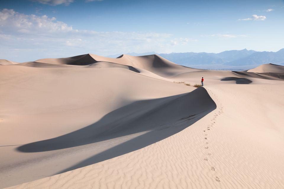 Tourist at Mesquite Sand Dunes, Death valley, USA