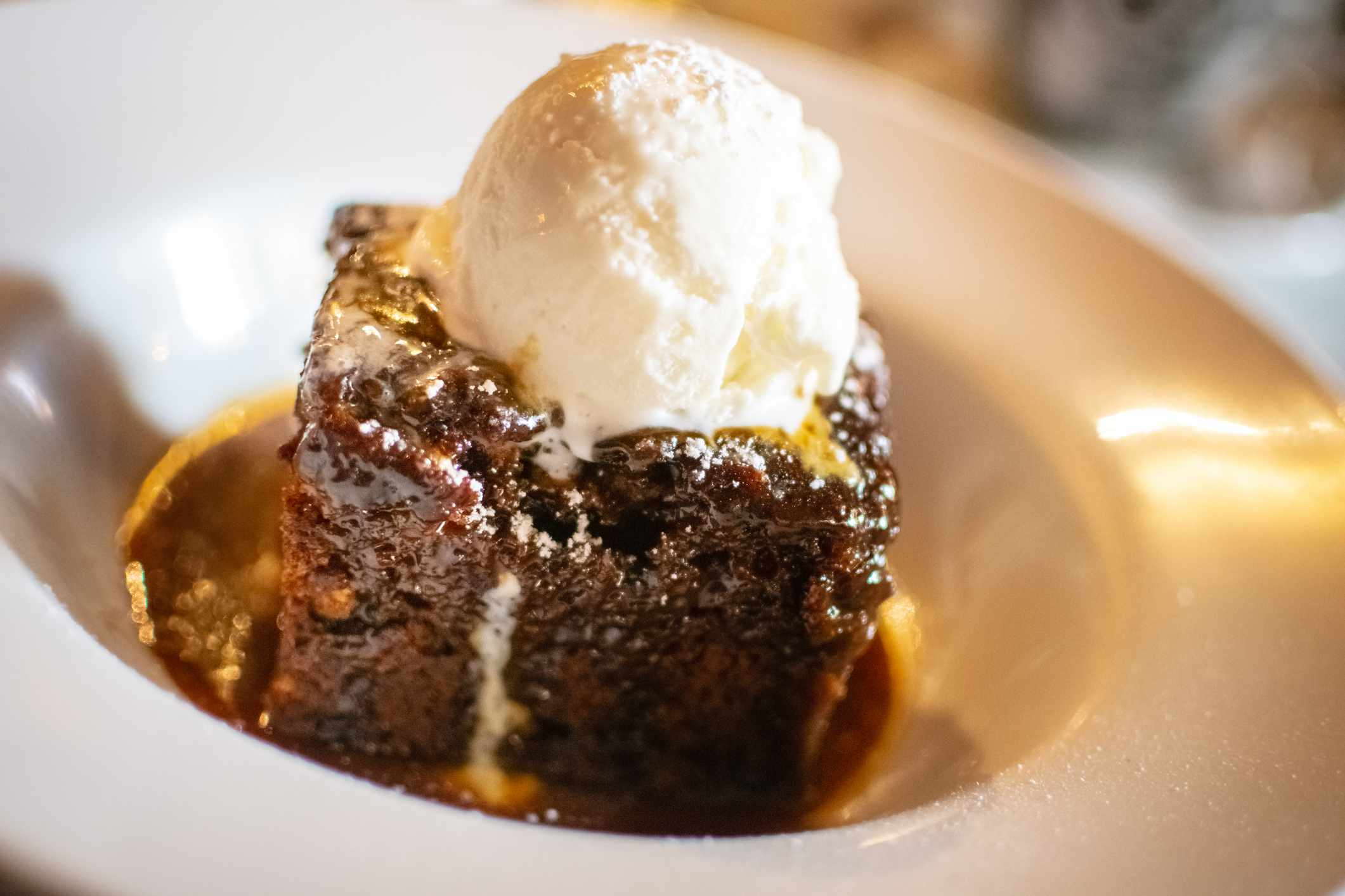 Sticky toffee pudding served with ice cream