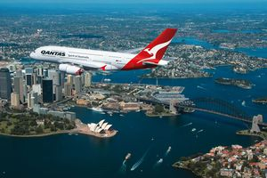 A Qantas Airbus A380 flying over Sydney Harbor