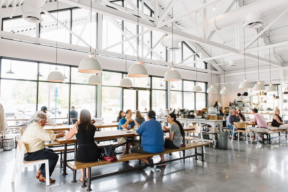 Customers eating at tables inside the Star Provisions in Atlanta.