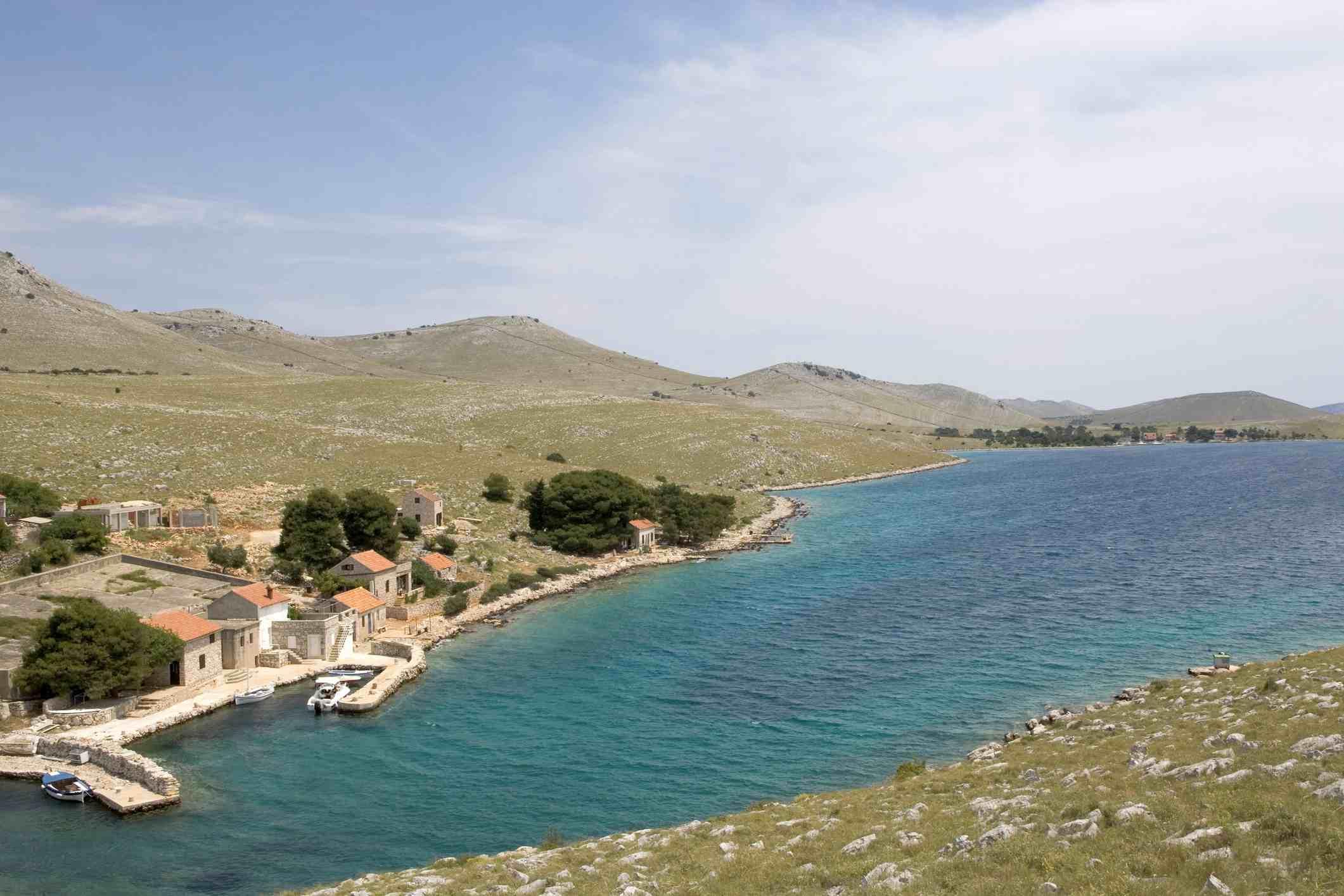 Croatia, Kornati Islands, Kornat, houses and small harbour on coastal inlet