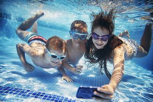 Kids under water with cell phone