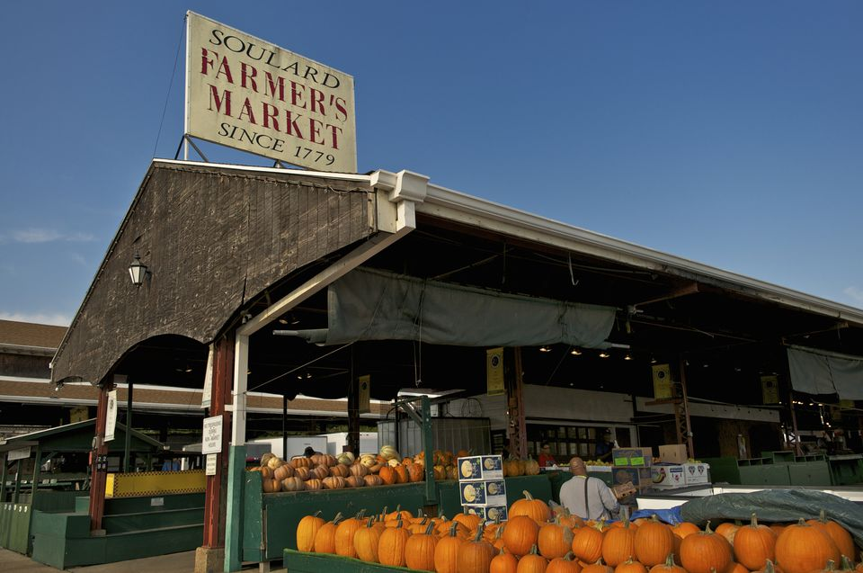 Soulard farmer's market sign and pumpkins for sale