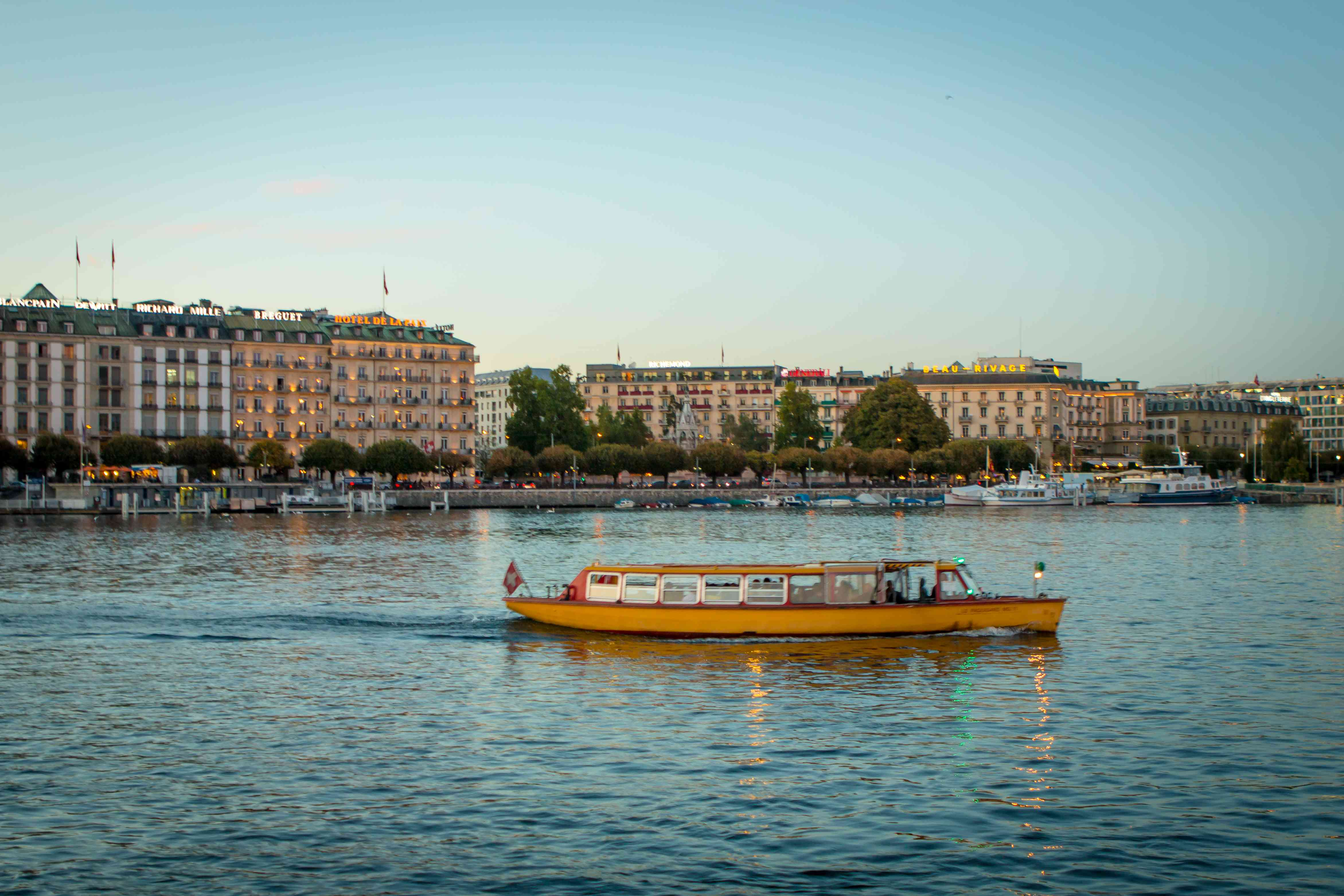 Geneva Switzerland lakeside with Mouette (Yellow boat)